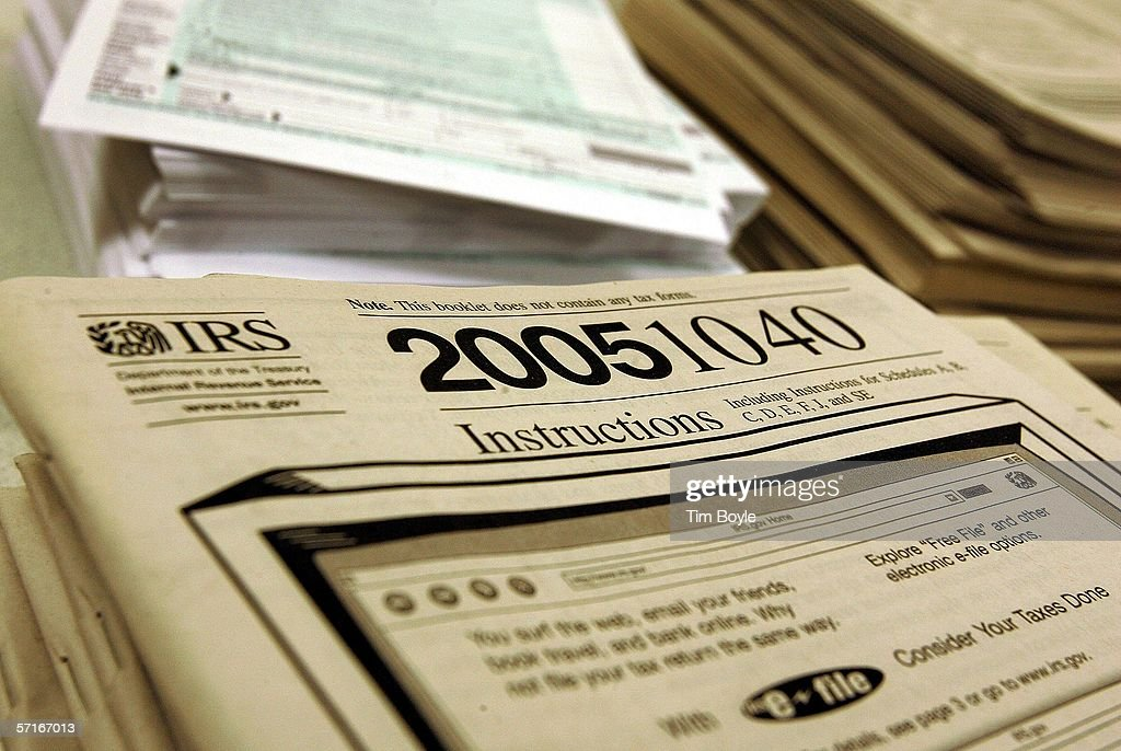 Instructions for the IRS 2005 1040 tax forms lie at the Des Plaines Public Library March 23, 2006 in Des Plaines, Illinois. As next month's income tax deadline approaches, Americans are preparing for it by using tax software, filing out paper forms or by using a tax preparer.