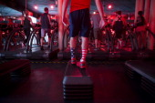 Instructor Barry Jay teaches a class at the Chelsea location of Barry's Boot Camp in New York US on Tuesday July 16 2013 Predawn and afternoon...