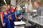Instructor Bjoern Weiss explains the gear sorting line to new trainees at a Siemens training center on September 3 2012 in Berlin Germany Nearly 400...