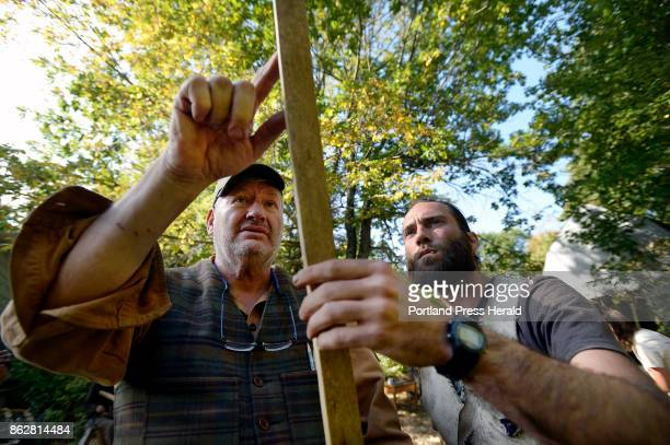 Instructor Bob Brooks left of Washingtonville NY looks over Colin Richardson's bow during The Maine Primitive Skills School's bow making class...