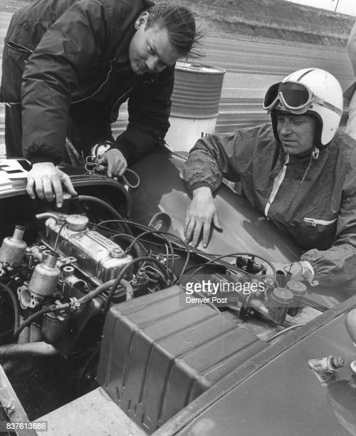 Instructor Bob Christiansen of Colorado Springs left shows driver Craig Schaefer how to look for oil leaks in the maze of engine oil lines after the...