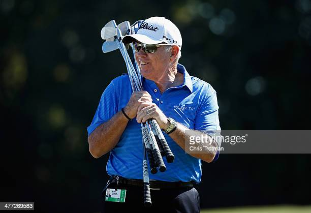 Instructor Butch Harmon waits on the practice ground during the third round of the World Golf ChampionshipsCadillac Championship at Trump National...