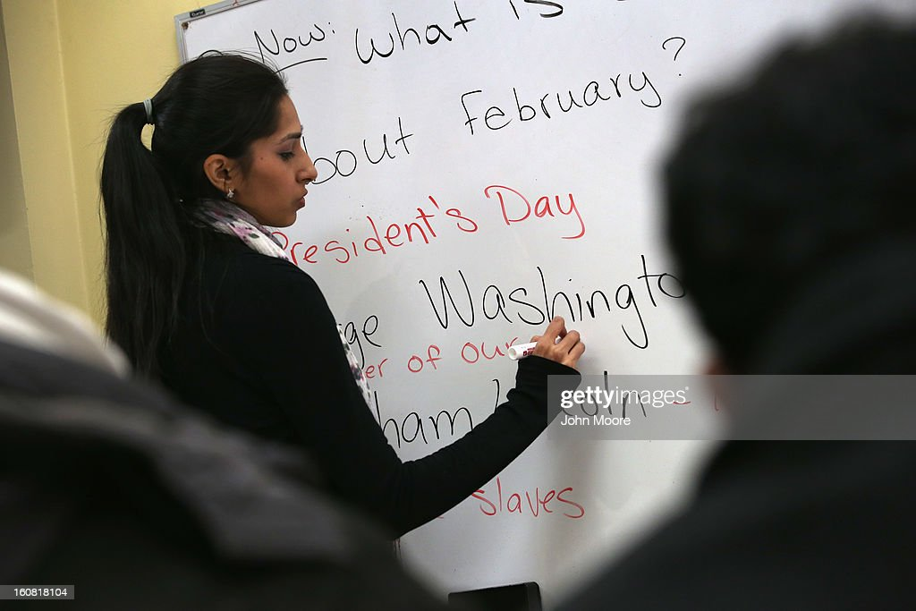 Instructor Fareeha Haq teaches Pakistani immigrants during an English and U.S. citizenship class at the office of the Council of Peoples Organization (COPO), on February 6, 2013 in New York City. The non-profit COPO, founded in early 2002 shortly after the 9/11 attacks, is designed to help immigrants, mostly from Pakistan, to learn English, assimilate to American culture and, in many cases, gain U.S. citizenship.