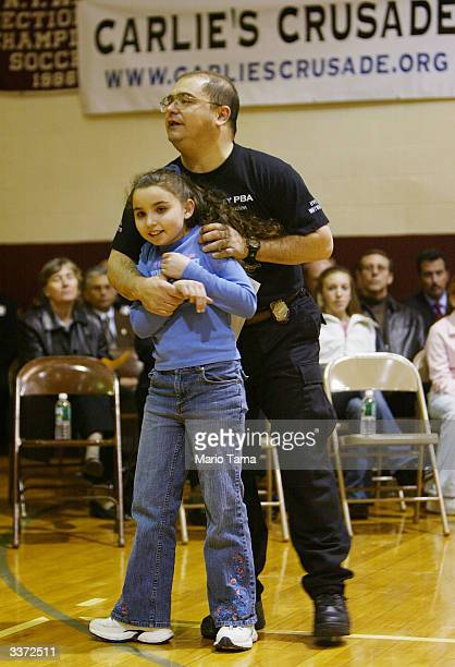 Instructor John Jenerose demonstrates selfdefense with Nicole Rochetti during a Carlie's Crusade REACT class in defense tactics primarily for girls...