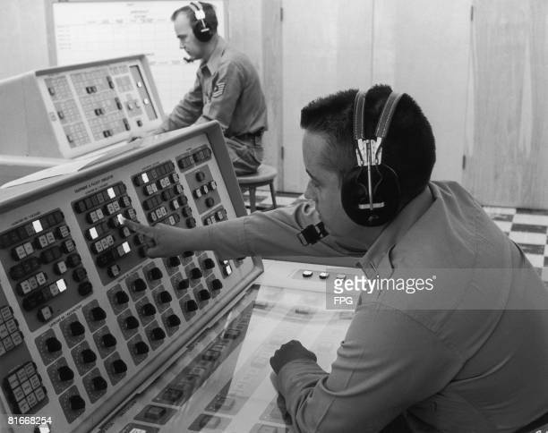 Instructor Lt Richard C Reynolds programmes a malfunction into the launch control trainer used in the Titan missile supervisors' and planners' course...
