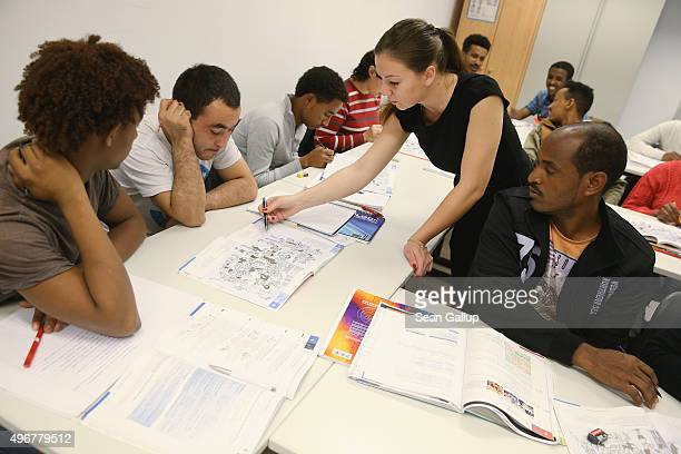 Instructor Paulina Kedziora leads an intermediate German language class for migrants and refugees from countries including Eritrea Afghanistan Iran...