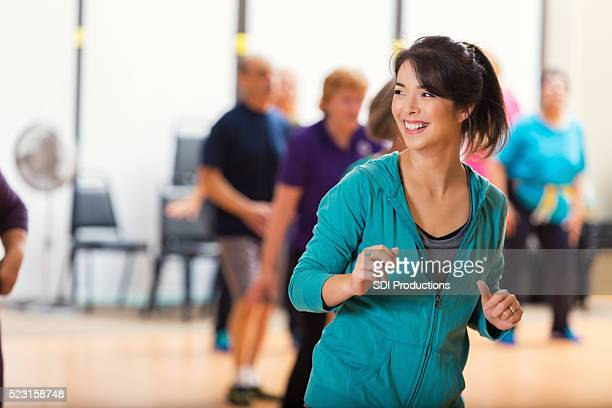 Instructor teaches group to line dance