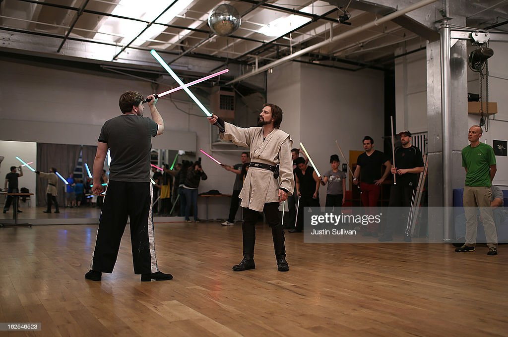 Instructors Alain Bloch (R) and Frank Knight (L) demonstrate combat moves with lightsabers during a Golden Gate Knights class in saber choreography on February 24, 2013 in San Francisco, California. Star Wars fans Alain Bloch and Matthew Carauddo founded the Golden Gate Knights in 2011 to teach classes on how to safely wield a lightsaber and perform choreographed moves. The three hour class costs ten dollars and all equipment is provided.