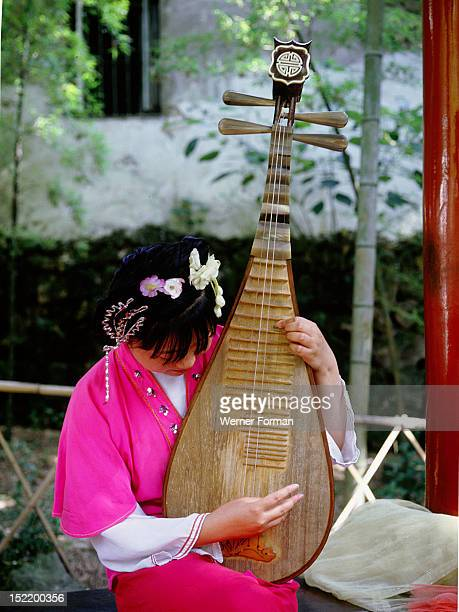 Instrument of ancient design played by a female musician dressed in Song style China 1980's Hangzhou Zhejiang province