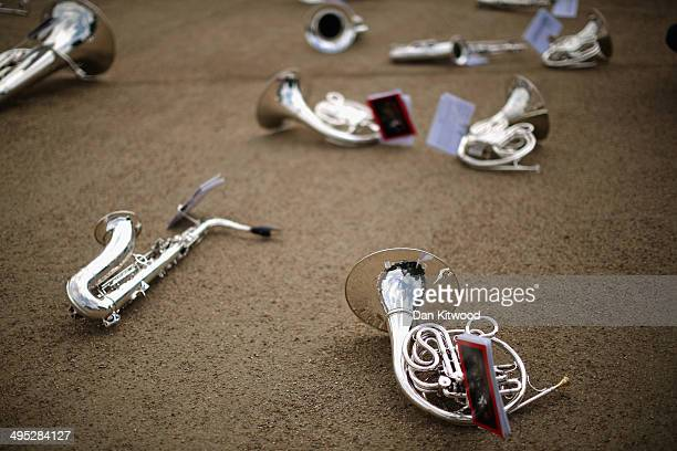 Instruments lie on the ground as members of the Royal Marines rehearse for the ceremonial 'Beating Retreat' event on Horse Guards Parade on June 2...
