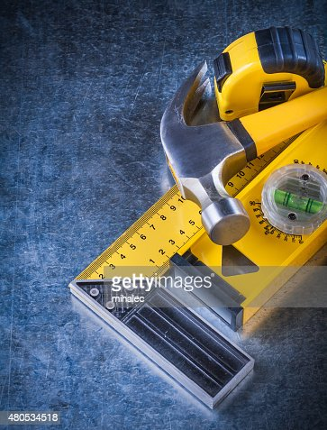 Instruments of measurement and claw hammer on scratched metallic : Stock Photo