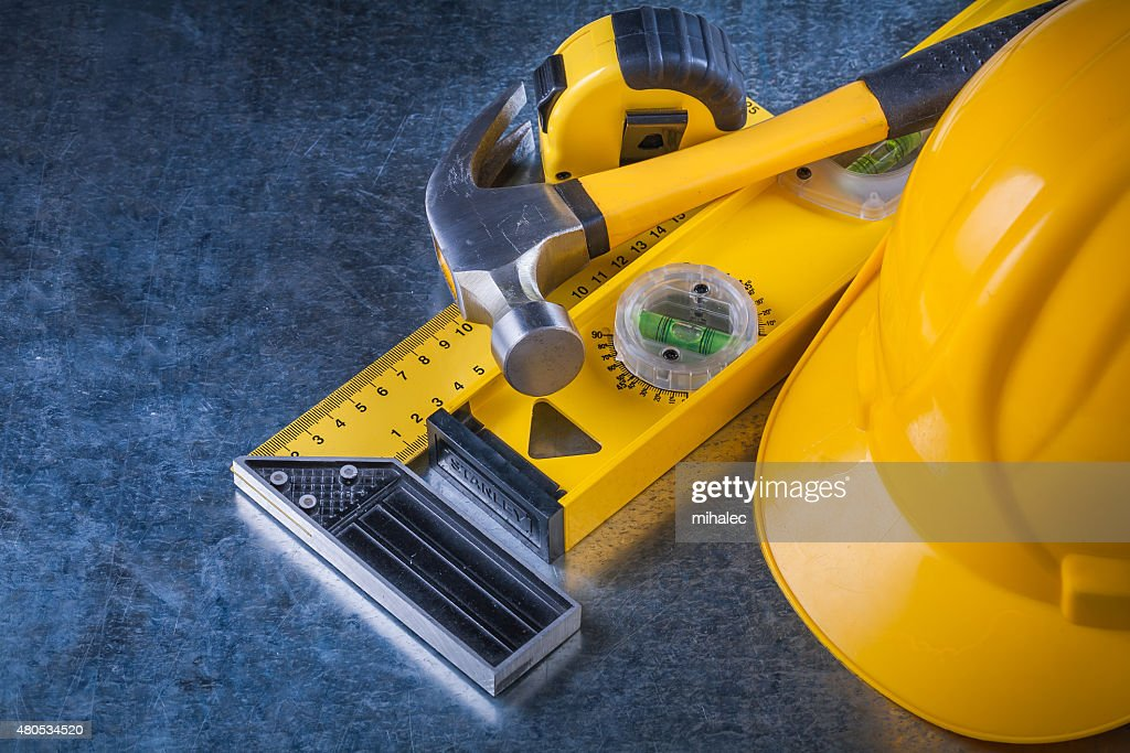 Instruments of measurement claw hammer and building helmet on sc : Stock Photo