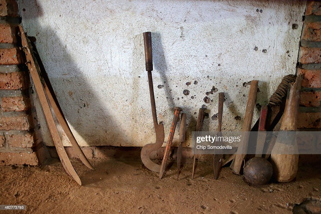 Instruments used to kill thousands including crude farm tools machetes clubs spikes spears and a canon ball are displayed inside the Ntarama Catholic...
