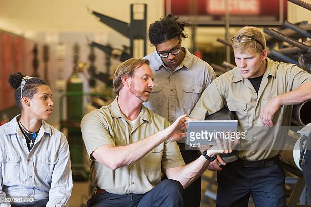 Instuctor and students in technical training school