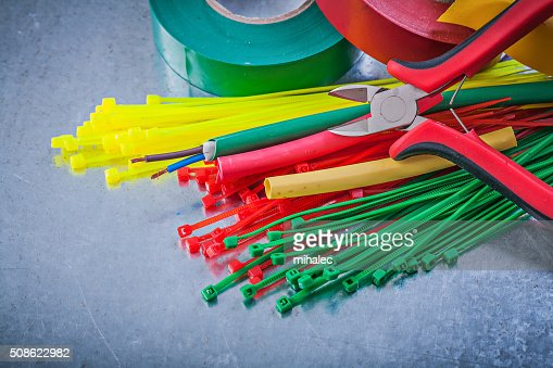 Insulating tapes plastic cable ties electric wires nippers : Stock Photo