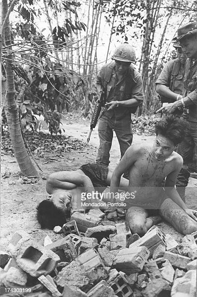 Insulting behavior of some Vietnamese soldiers to a Viet Cong corpse War in Vietnam Saigon suburbs June 1968