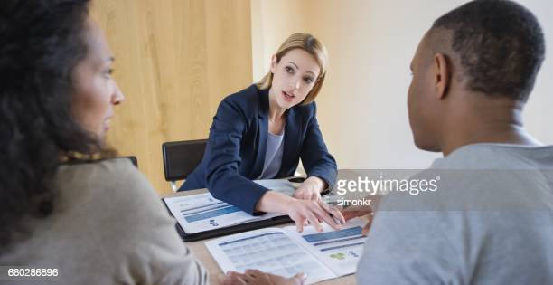 Insurance agent discussing with couple