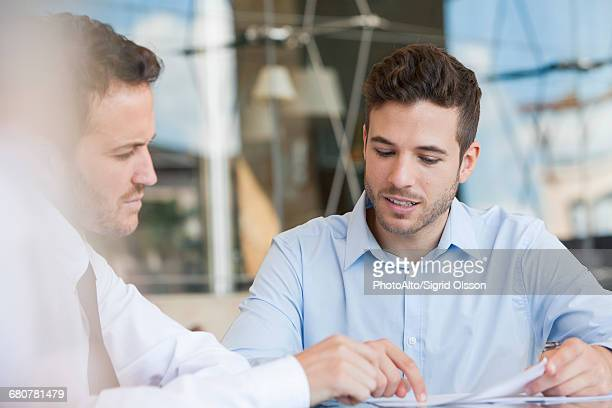 Insurance agent explaining contact to client