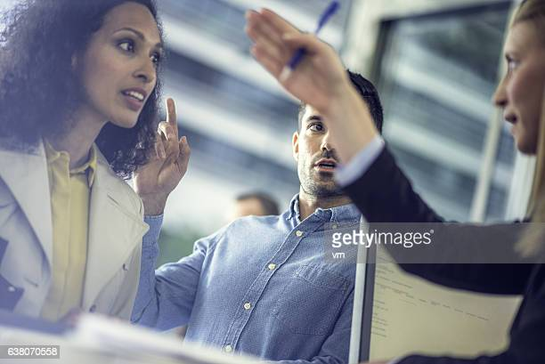 Insurance agent giving directions to a couple