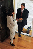 Insurance agent making home visit