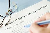 insurance claim form on blue background