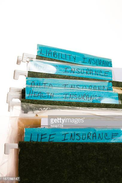 Insurance papers from a file drawer