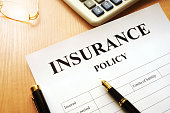 Insurance policy on a desk.