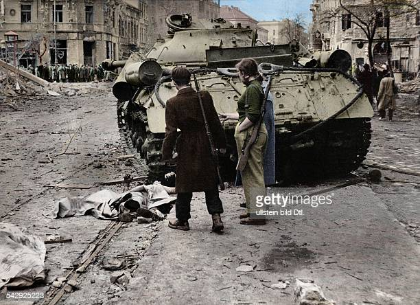 Insurgents in front of an abandoned Soviet tank in Budapest November 1956