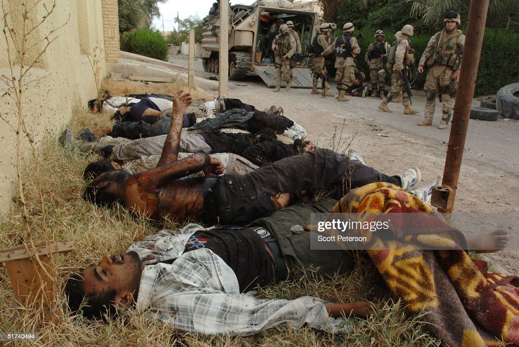 Insurgents killed by U.S. Marines during the assault on Fallujah lie on the ground November 14, 2004 in Iraq. U.S. and Iraqi forces continue to push their offensive in Fallujah, battling remaining pockets of resistance.