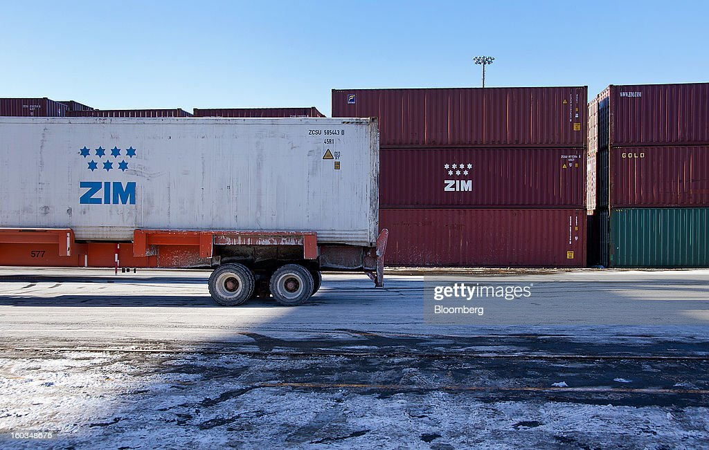 ZIM Integrated Shipping Services Ltd. freight containers sit stacked at the Port Of Halifax's South End container terminal, operated by Halterm Ltd., in Halifax, Nova Scotia, Canada, on Tuesday, Jan. 29, 2013. Statistics Canada (STCA) is scheduled to release gross domestic product data on Jan. 31. Photographer: Aaron McKenzie Fraser/Bloomberg via Getty Images