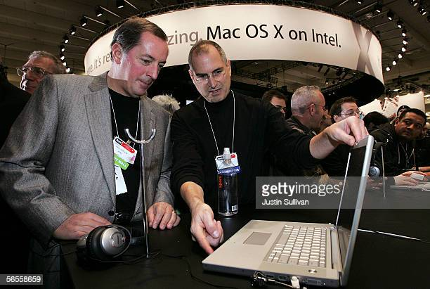 Intel CEO Paul Otellin and Apple CEO Steve Jobs look at a new MacBook Pro laptop with Intel Core Duo processor during the 2006 Macworld January 10...
