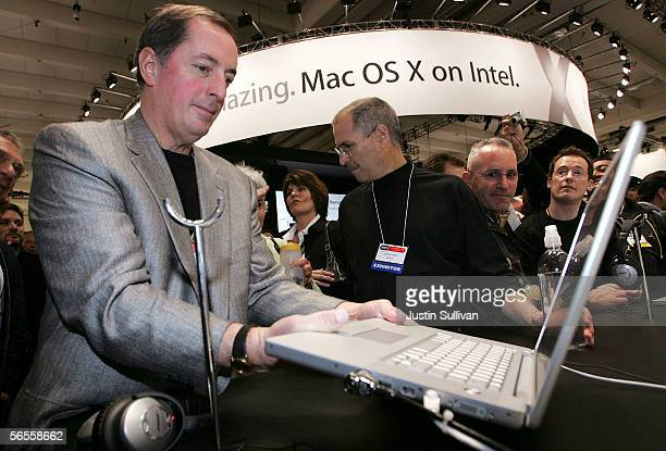 Intel CEO Paul Otellini and Apple CEO Steve Jobs look at a new MacBook Pro laptop with Intel Core Duo processor during the 2006 Macworld January 10...