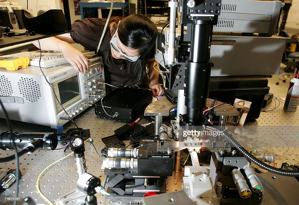 Intel Corporation scientist Ling Liao adjusts a pseudo random bits sequence generator inside a lab at company headquarters September 18, 2006 in Santa Clara, California. Intel announced today that its researchers, teamed up with researchers from the University of California, Santa Barbara, have successfully used standard silicon manufacturing processes to build the world?s first electrically powered Hybrid Silicon Laser, a key element in producing low-cost, high-bandwidth silicon photonics devices for use inside and around future computers and data centers.