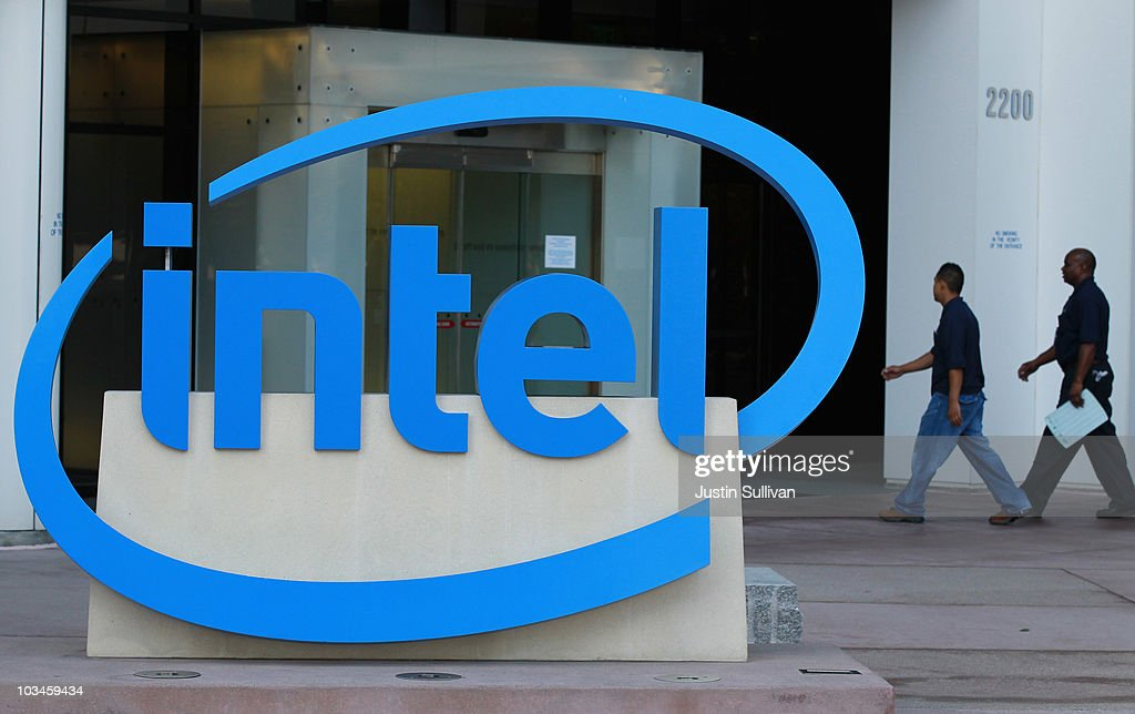 Intel employees walk by a sign as they enter the office August 19, 2010 in Santa Clara, California. Intel announed today that it plans to buy security software maker McAfee for a reported $7.68 billion.