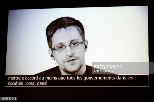 US intelligence contractor and whistle blower Edward Snowden delivers a speech by video conference during a masterclass at the Maison de la Radio in...