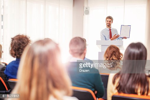 Intelligent business person showing graph on seminar