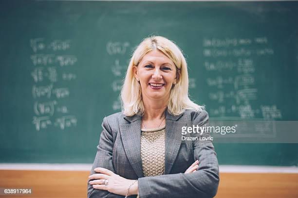 Intelligent matur female math professor in classroom