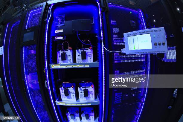 Intelligent Temperature Tester units sit on leadacid batteries in a server rack in the Huawei Technologies Co Ltd pavilion at the CeBIT 2017 tech...