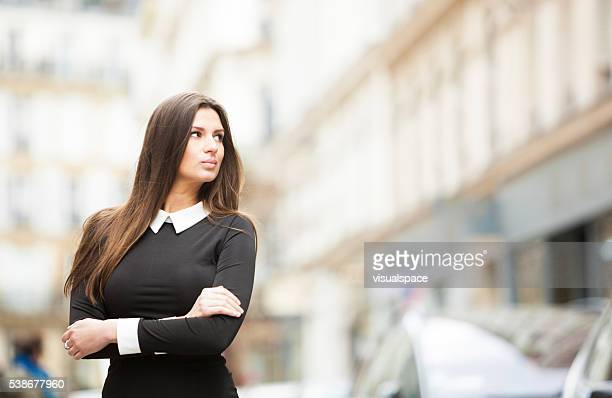 Intelligent Young Woman's Portrait In A City Street