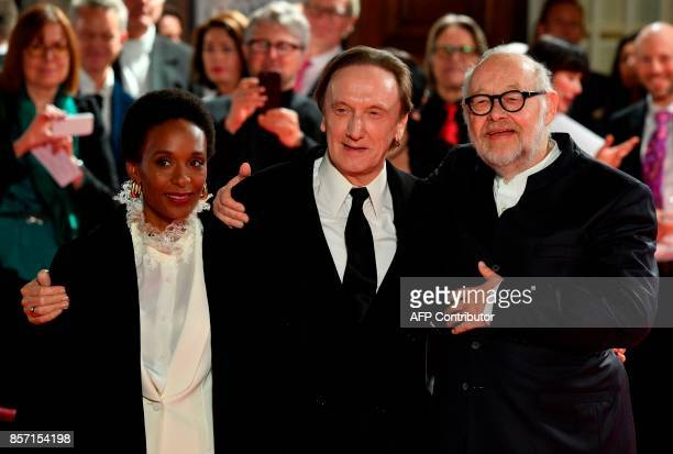 Intendant of the State Opera Juergen Flimm poses with German singer Marius Mueller Westernhagen and his partner Lindiwe Suttle during the reopening...