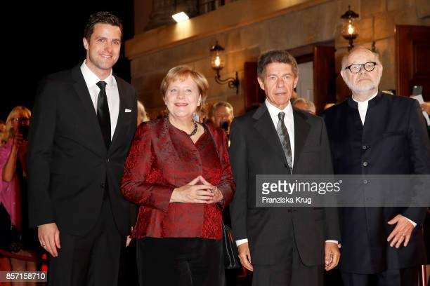 Intendants of the State Opera Juergen Flimm and Matthias Schulz pose with German Chancellor Angela Merkel and her husband Joachim Sauer attend the...