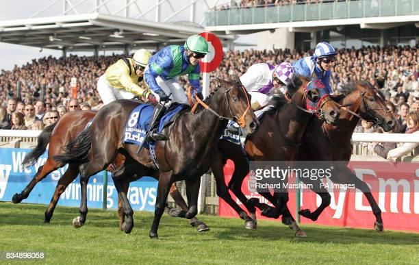 Intense Focus ridden by jockey Kevin Manning goes on to win the Darley Dewhurst Stakes ahead of second place Lord Shanakill ridden by jockey Jim...