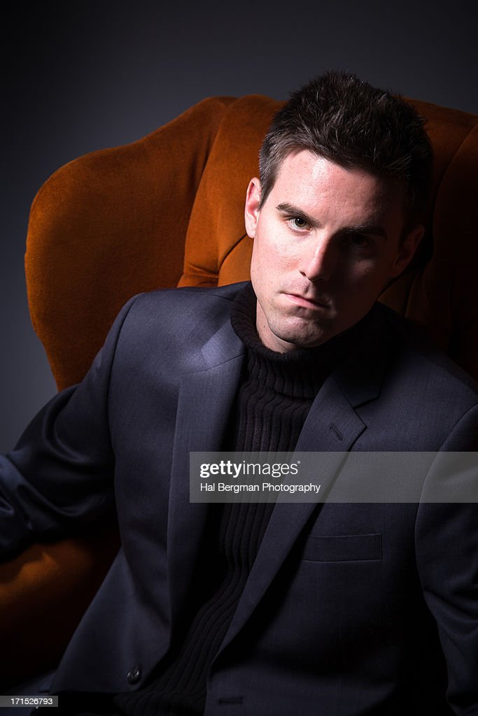 Intense Man in Red Chair : Stock Photo
