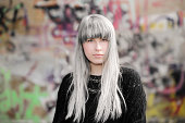 beautiful woman with gray hair intense portrait;outdoors shoot.