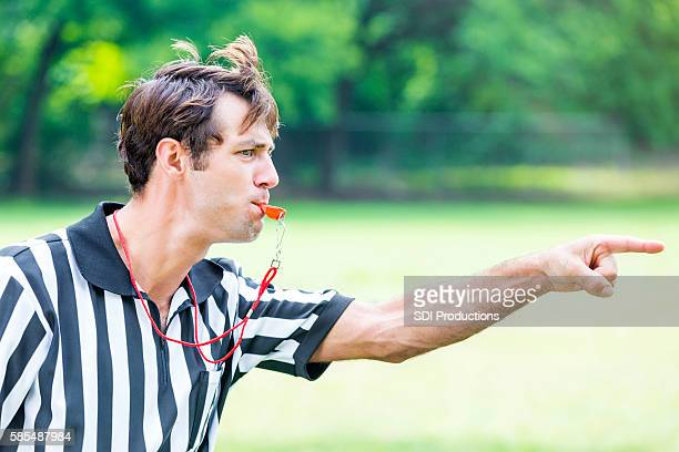 Intense referee calls penalty during sporting event