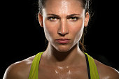 Strong strength confidence power determination relentless conviction female athlete trainer conceptual Boxer fighter MMA tough woman athlete exercise training posing portrait champion intimidating Int