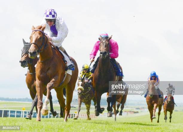 Intense Style and jockey Kevin Manning win the opening Elusive Pimpernel EBF Maiden during the Guineas Spring Festival at The Curragh Racecourse Co...
