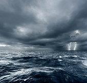 Intense thunderstorm over ocean with lightning.
