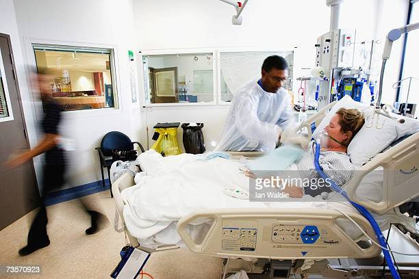 Intensive Care Unit director Dr Yugan Mudaliar tends to ICU patient Christine Henderson at Westmead Hospital March 12 2007 in Sydney Australia Each...