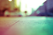 Intentionally blurred colorful filtered view of a concrete sidewalk - abstract background